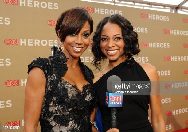 Actress Holly Robinson Peete and carpet hostess Nischelle Turner attend the CNN Heroes An All Star Tribute at The Shrine Auditorium on December 2...
