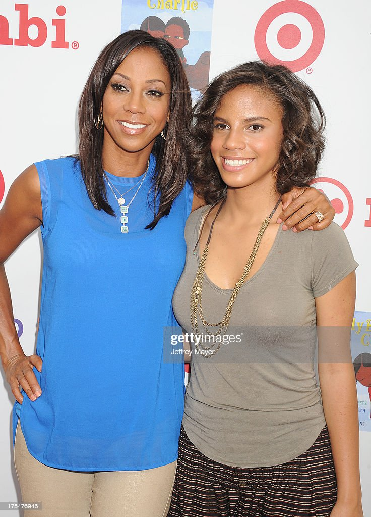 Actress Holly Robinson Peete and daughter Ryan Elizabeth Peete arrive at HollyRod Foundation's 4th Annual 'My Brother Charlie' Carnival at Culver Studios on August 3, 2013 in Culver City, California.