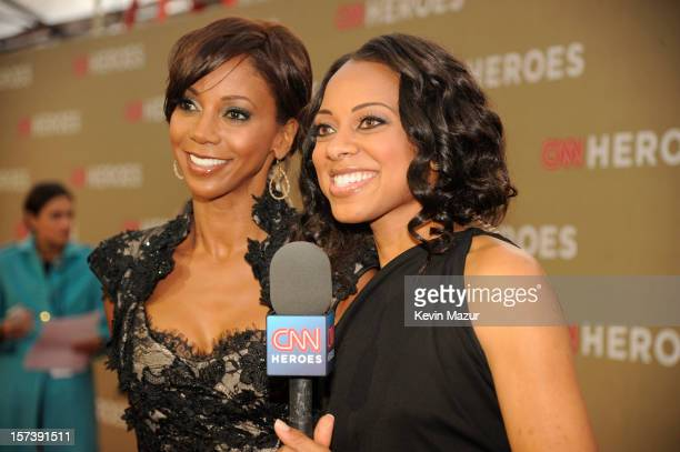 Actress Holly Robinson Peete and red carpet hostess Nischelle Turner attend the CNN Heroes An All Star Tribute at The Shrine Auditorium on December 2...