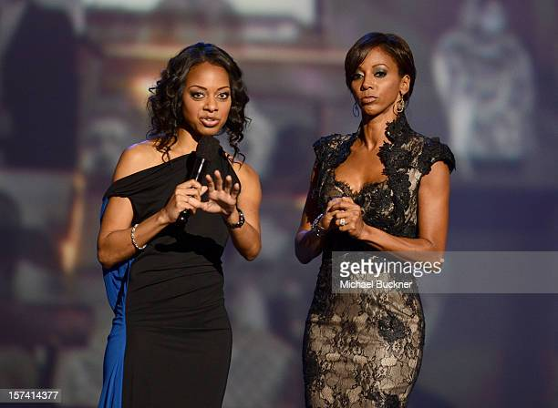Actress Holly Robinson Peete and show host Nischelle Turner speak onstage during the CNN Heroes An All Star Tribute at The Shrine Auditorium on...