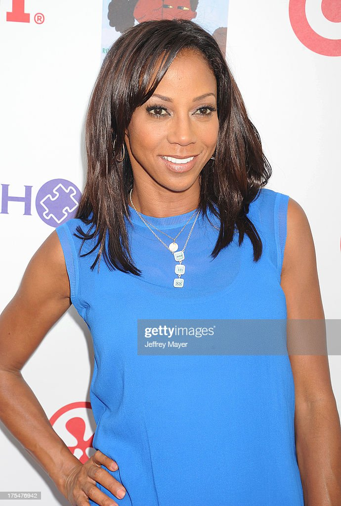 Actress Holly Robinson Peete arrives at HollyRod Foundation's 4th Annual 'My Brother Charlie' Carnival at Culver Studios on August 3, 2013 in Culver City, California.