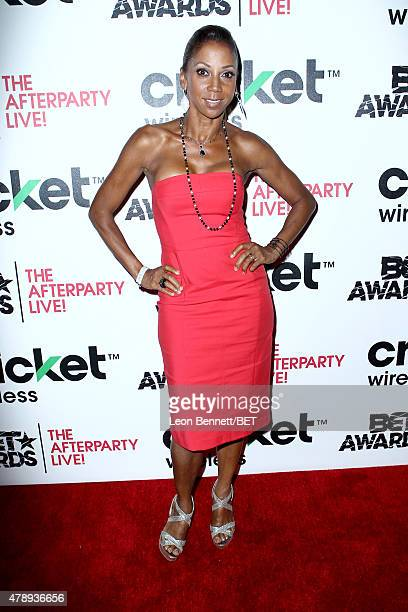 Actress Holly Robinson Peete poses in the Cricket green lounge during the 2015 BET Awards at the Microsoft Theater on June 28 2015 in Los Angeles...