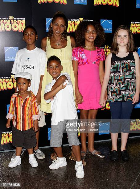 Actress Holly Robinson Peete with her children and a guest arrive at the Los Angeles premiere of the film Fly Me To The Moon held at the Directors...
