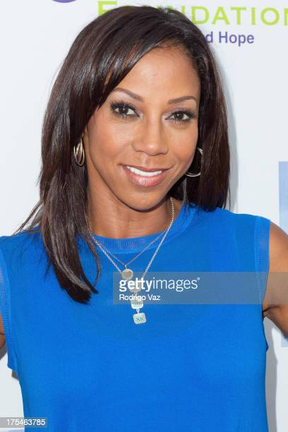 Actress Holly Robinson Pete arrives at HollyRod Foundation's 4th Annual My Brother Charlie Carnival at Culver Studios on August 3 2013 in Culver City...
