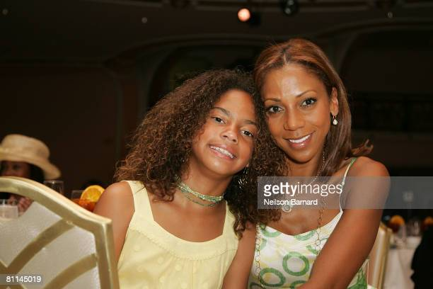 Actress Holly RobinsonPeete and daughter pose for a photograph at the Victoria Rowell Steps Out For High Tea At Noon event at the Beverly Hills Hotel...