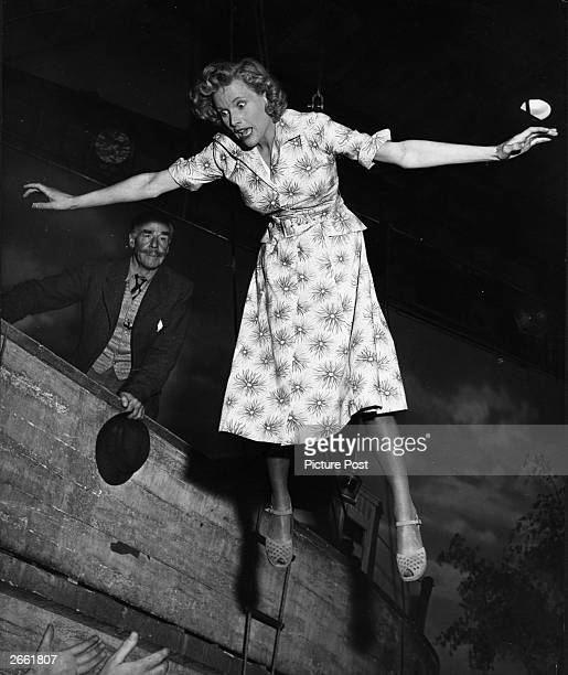 Actress Honor Blackman being lowered by a ship's windlass for a scene in the film 'Green Grow The Rushes' directed by Derek N Twist and produced by...