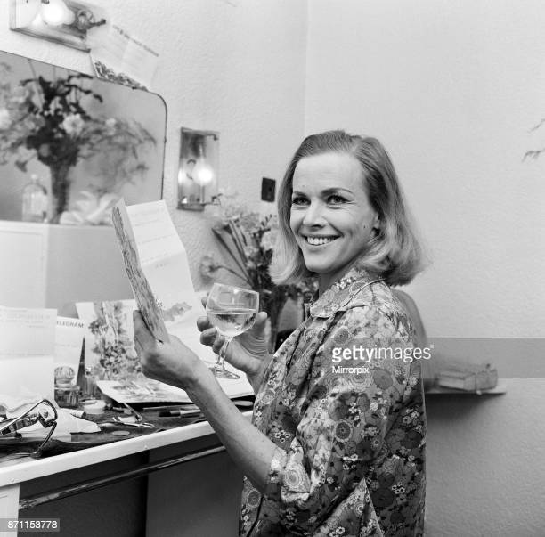 Actress Honor Blackman reads telegrams of congratulations in her dressing room at Manchester Palace Theatre, including one from Noel Coward which...