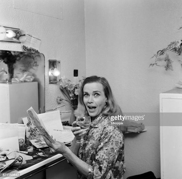 Actress Honor Blackman reads telegrams of congratulations in her dressing room at Manchester Palace Theatre including one from Noel Coward which read...