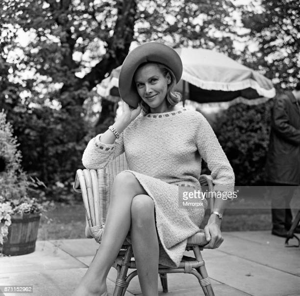 Actress Honor Blackman relaxes in her garden party outfit during the filming of 'Life at the Top' at Bingley Yorkshire 24th May 1965