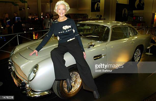 Actress Honor Blackman who played the part of Pussy Galore in the film Goldfinger poses for poses on an Aston Martin DB5 car at the Bond James Bond...