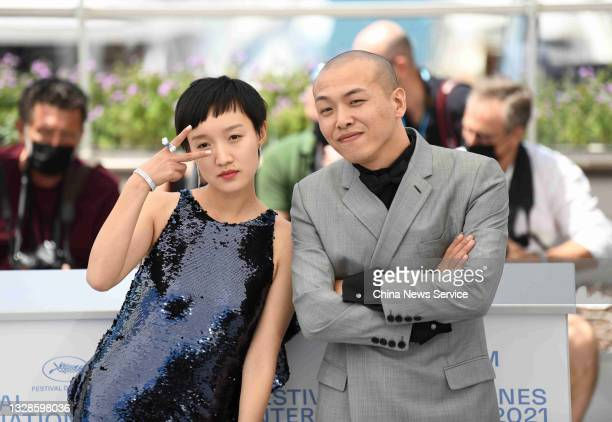 """Actress Huang Miyi and director Na Jiazuo attend the photocall of film """"Streetwise"""" during the 74th annual Cannes Film Festival on July 13, 2021 in..."""