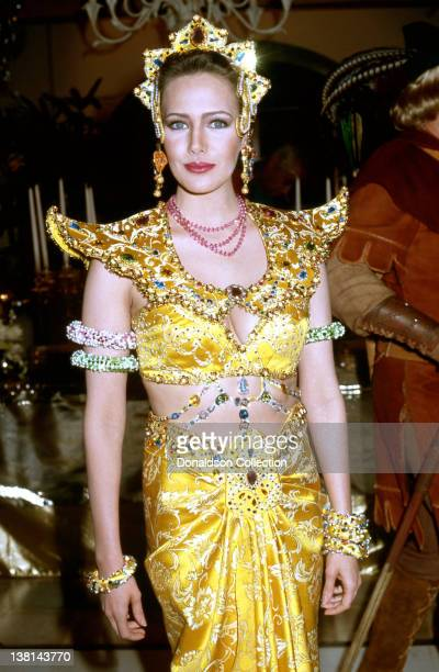 Actress Hunter Tylo attends an event wearing an intricately bejewelled dress and head dress in March 1992 in Los Angeles California