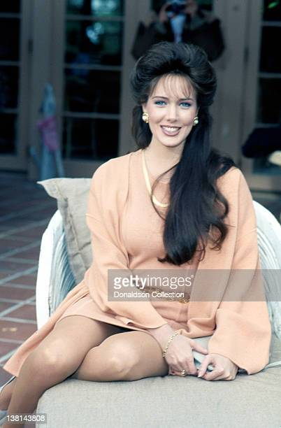 Actress Hunter Tylo poses for a portrait session at her home in December 1990 in Los Angeles California