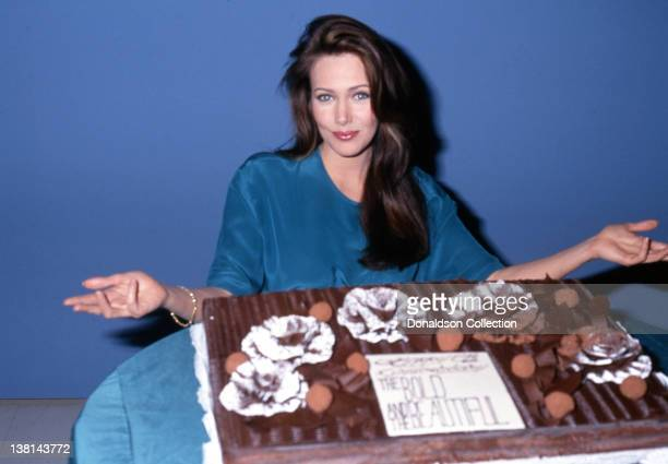 Actress Hunter Tylo poses for a portrait with a cake celebrating her time on the show The Bold And The Beautiful in 1991 in Los Angeles California