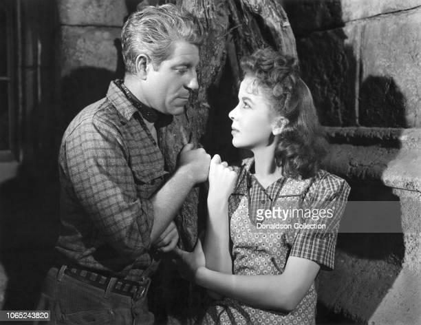 """Actress Ida Lupino and Jean Gabin in a scene from the movie """"Moontide"""""""
