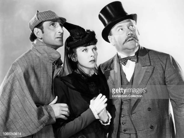 Actress Ida Lupino Basil Rathbone and Nigel Bruce in a scene from the movie The Adventures of Sherlock Holmes