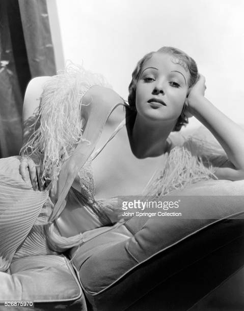 Actress Ida Lupino Reclining on Couch