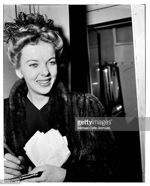 Actress Ida Lupino signs her autograph for fans in Los Angeles California