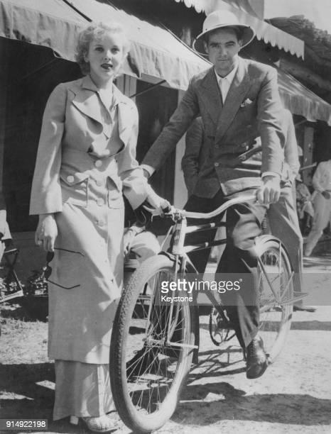 Actress Ida Lupino talks to producer Howard Hughes during a holiday in Palm Springs, California, circa 1940.