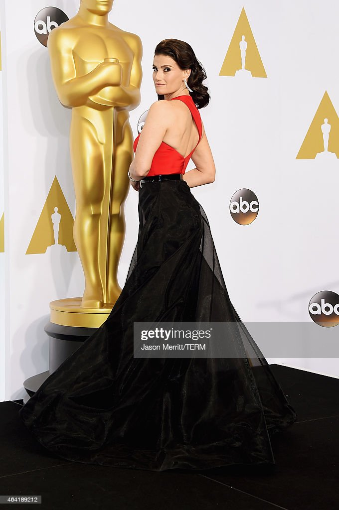 Actress Idina Menzel poses in the press room during the 87th Annual Academy Awards at Loews Hollywood Hotel on February 22, 2015 in Hollywood, California.