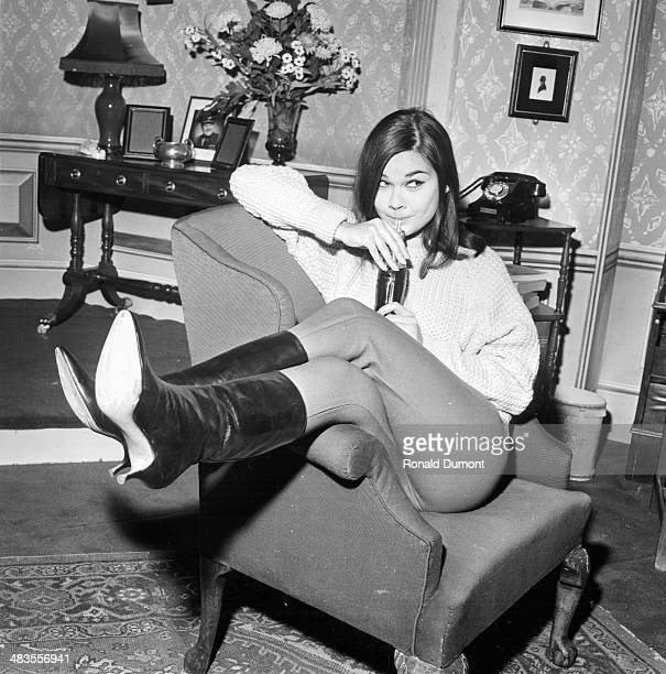 Actress Imogen Hassall posing in an armchair 1st January 1964