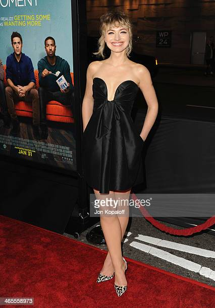 Actress Imogen Poots arrives at the Los Angeles Premiere 'That Awkward Moment' at Regal Cinemas LA Live on January 27 2014 in Los Angeles California