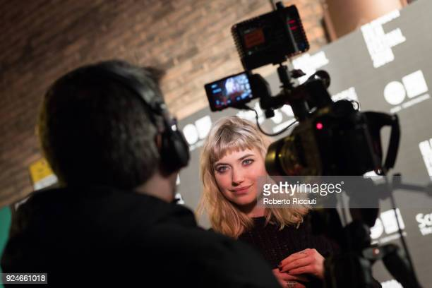 Actress Imogen Poots gives a TV interview at the UK Premiere of 'Mobile Homes' during the 14th Glasgow Film Festival at Glasgow Film Theatre on...
