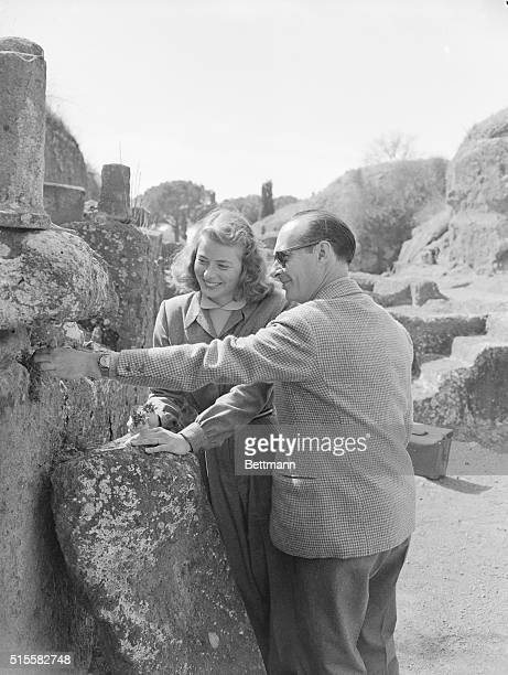 Actress Ingrid Bergman and director Roberto Rossellini inspect the Etruscan ruins Bergman is in Italy to make a new film
