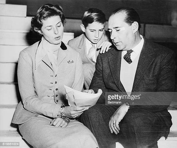 Actress Ingrid Bergman and her husband director Roberto Rossellini go over the script of the dramatic opera Joan of Arc at the stake in which Miss...