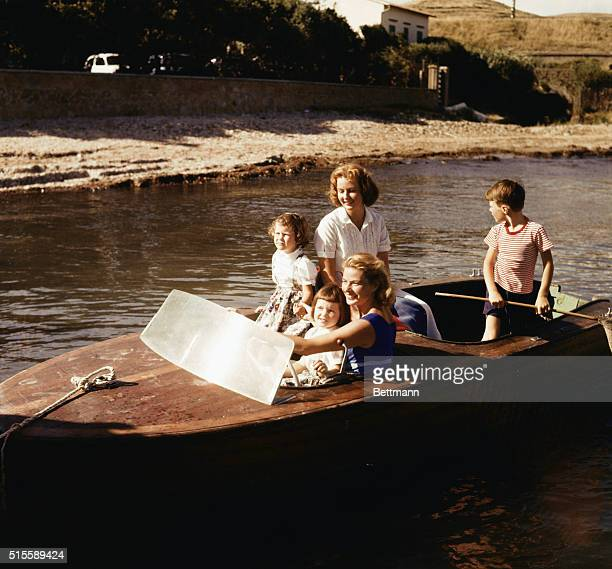 Actress Ingrid Bergman drives a motor boat with her son Roberto Rossellini the twins Isabella and Isotta Rossellini and her eldest daughter Pia...