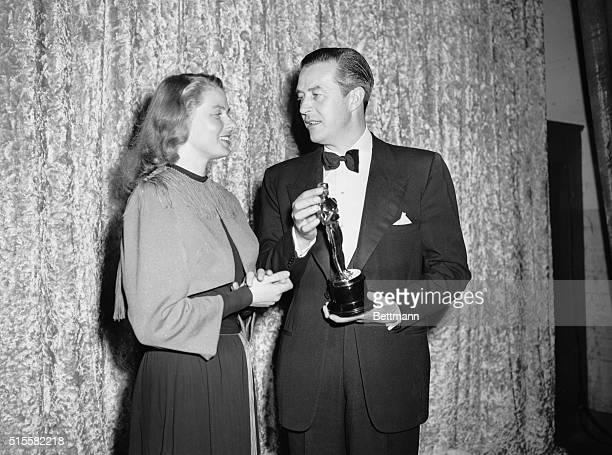 Actress Ingrid Bergman winner of the Best Actress Oscar for her role in Gaslight presents actor Ray Milland with the Oscar for Best Actor for his...