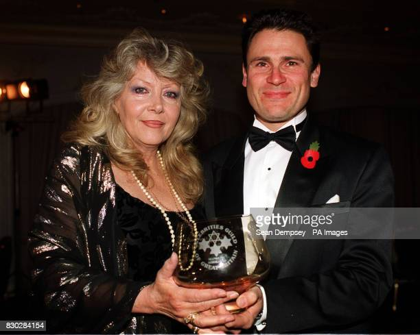 Actress Ingrid Pitt presents Chris Moon from Basingstoke Hampshire with his award during the 1999 Unsung Heroes awards ceremony at the Four Season...
