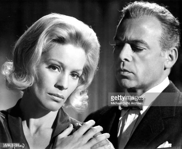 Actress Ingrid Thulin and actor Herbert Lom on set of the movie Return from the Ashes in 1965