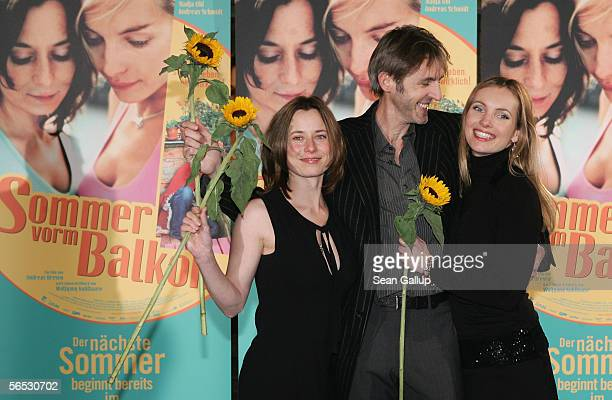 Actress Inka Friedrich actor Andreas Schmidt and actress Nadja Uhl arrive for the premiere of the new German comedy film Sommer vorm Balcon January 5...
