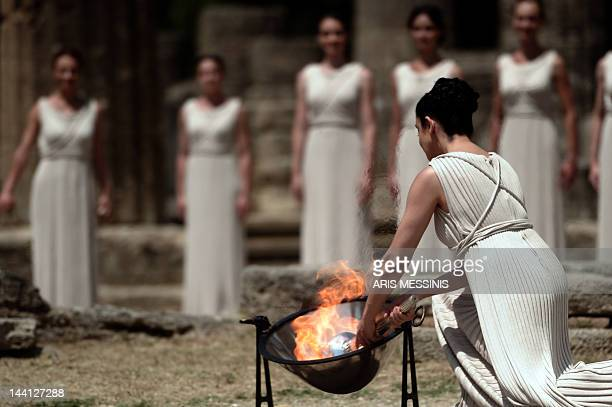 Actress Ino Menegaki acting as high priestess lights the Olympic Flame on May 10 2012 during the lighting ceremony in ancient Olympia the sanctuary...