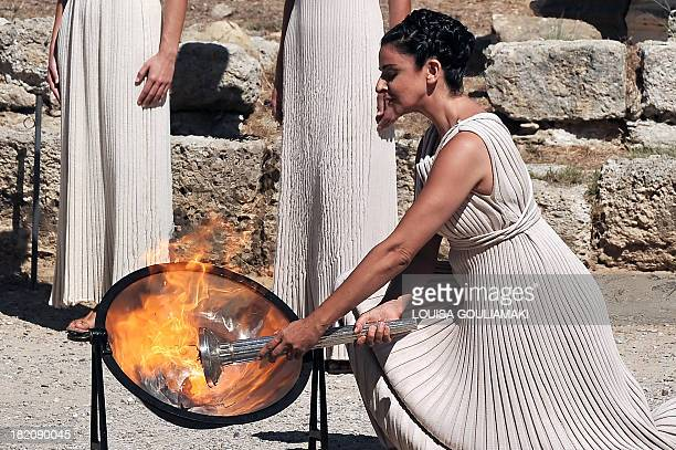 Actress Ino Menegaki in the role of High Priestess lights the Olympic Flame from sun rays during the final dress rehearsal of the Flame lightining...