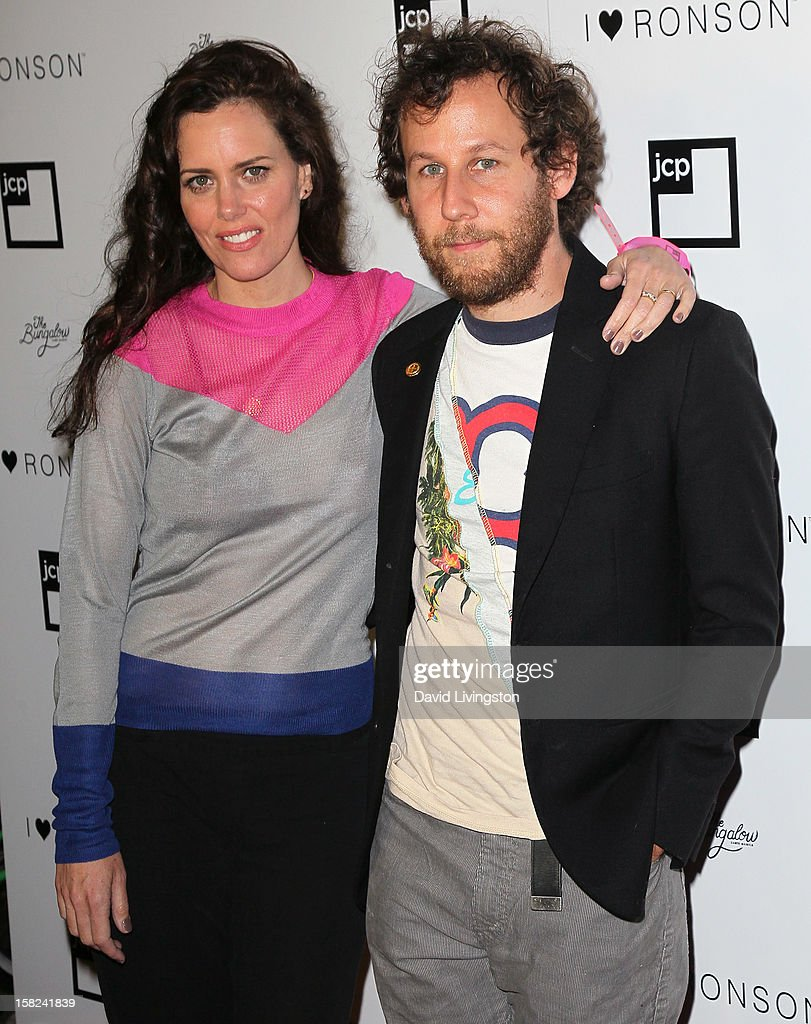 Actress Ione Skye (L) and husband musician Ben Lee attend the 'I Heart Ronson' Collection and jcpenney celebration at The Bungalow on December 11, 2012 in Santa Monica, California.
