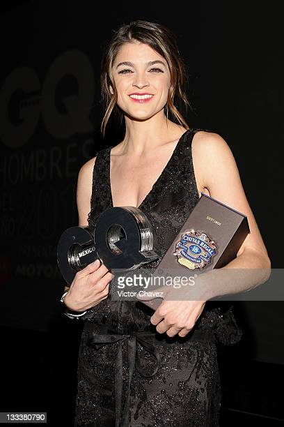 """Actress Irene Azuela recieves woman of the year award during the GQ's 2011 """"Men of the Year"""" party held at Salon Arcos Bosques on November 17, 2011..."""