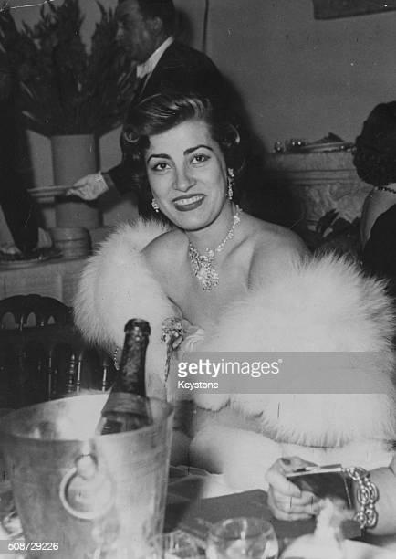 Actress Irene Papas wearing a fut stole as she attends a ball at the Palais de Chaillot Paris circa 1965
