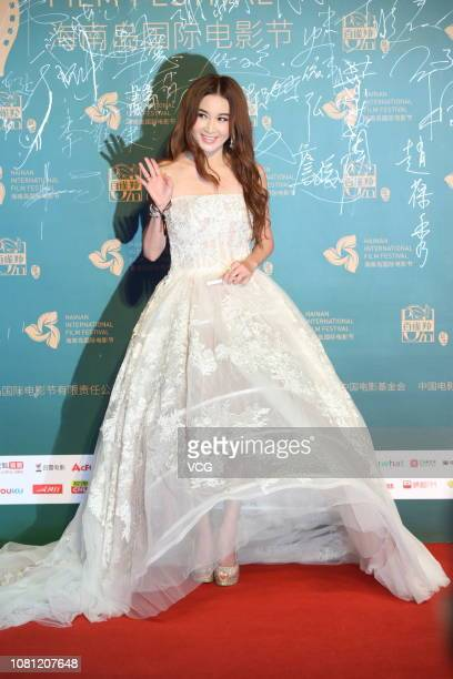 Actress Irene Wan Bikha poses on the red carpet during the opening ceremony of the 1st Hainan International Film Festival on December 11 2018 in...