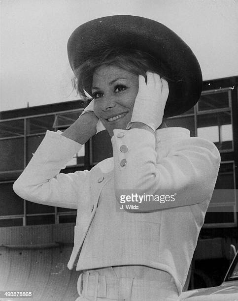 Actress Irina Demick arriving at London Airport to promote her film 'Prudence and the Pill', August 5th 1968.