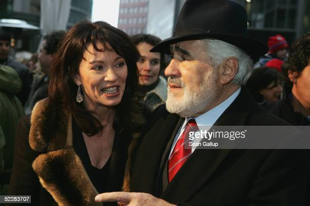 """Actress Iris Berben and actor Mario Adorf arrive at the German premiere of """"Racing Stripes"""" on March 6, 2005 in Berlin, Germany."""