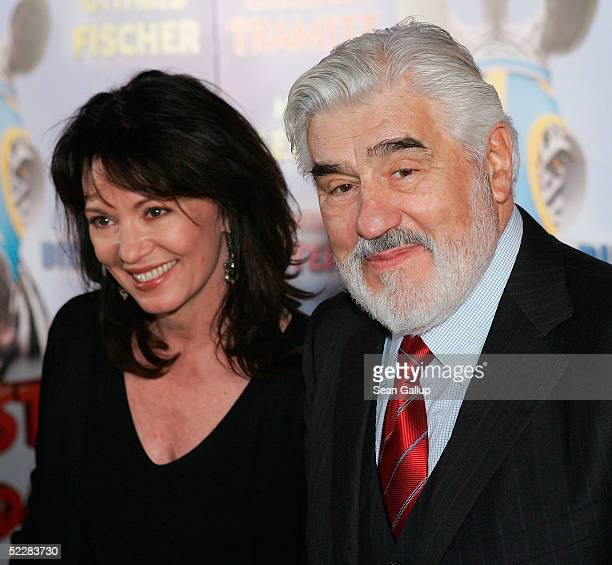 """Actress Iris Berben and actor Mario Adorf attend the German premiere of """"Racing Stripes"""" on March 6, 2005 in Berlin, Germany."""