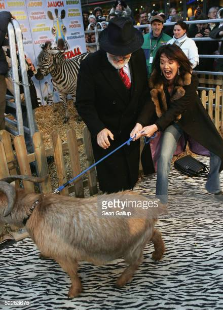 """Actress Iris Berben and actor Mario Adorf clown with a zebra at the German premiere of """"Racing Stripes"""" on March 6, 2005 in Berlin, Germany."""