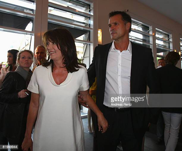 Actress Iris Berben and her friend Heiko Kiesow attend the 'The Corner and Vogue Cocktail' reception during the Mercedes Benz Fashion Week...