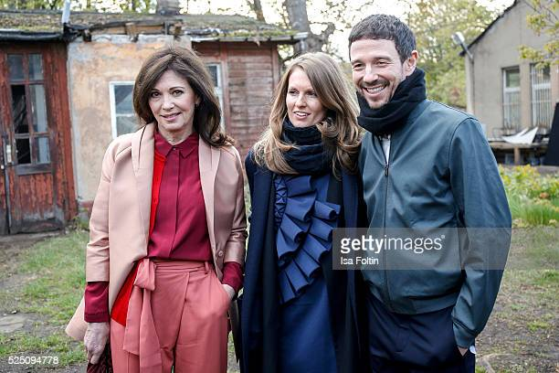 Actress Iris Berben wearing a dress of COS with her daughterinlaw Katrin Kraus wearing a dress of COS and her son producer Oliver Berben attend the...