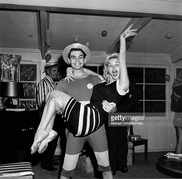 Actress Irish McCalla and Pat McIntyre attend a party in Los AngelesCA