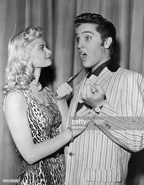 Actress Irish McCalla playfully threatens Elvis Presley with a knife while on The Milton Berle Show.