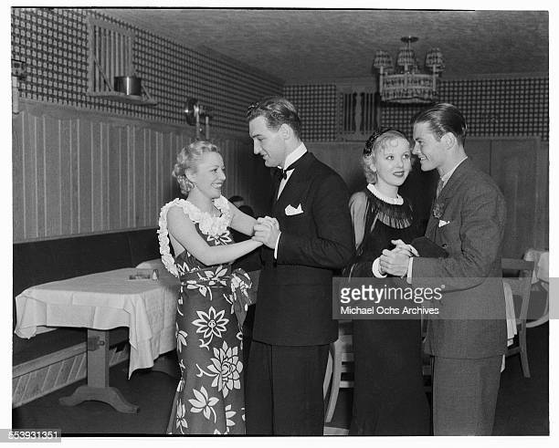 Actress Isabel Jewell dances with actor William Tannen and actress Ida Lupino dances with a friend at Cafe Trocadero in Los Angeles California