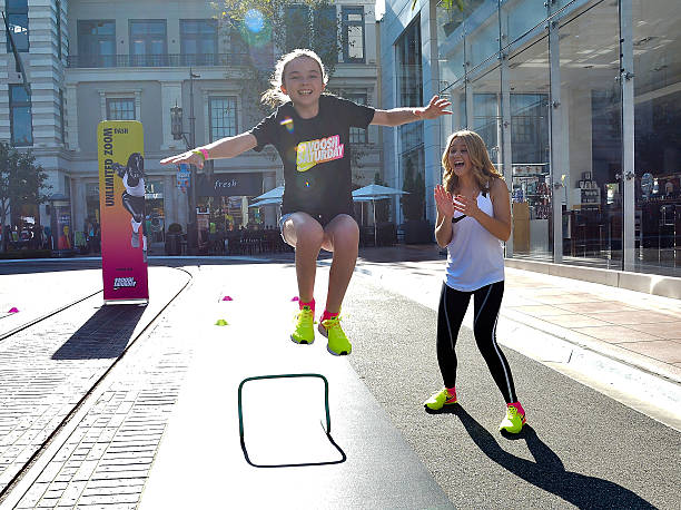 9af6bae897498 Photos et images de Nike Young Athletes Swoosh Saturday Featuring ...
